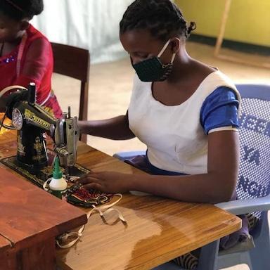 Bandari womens project participant sewing face masks at sewing machine