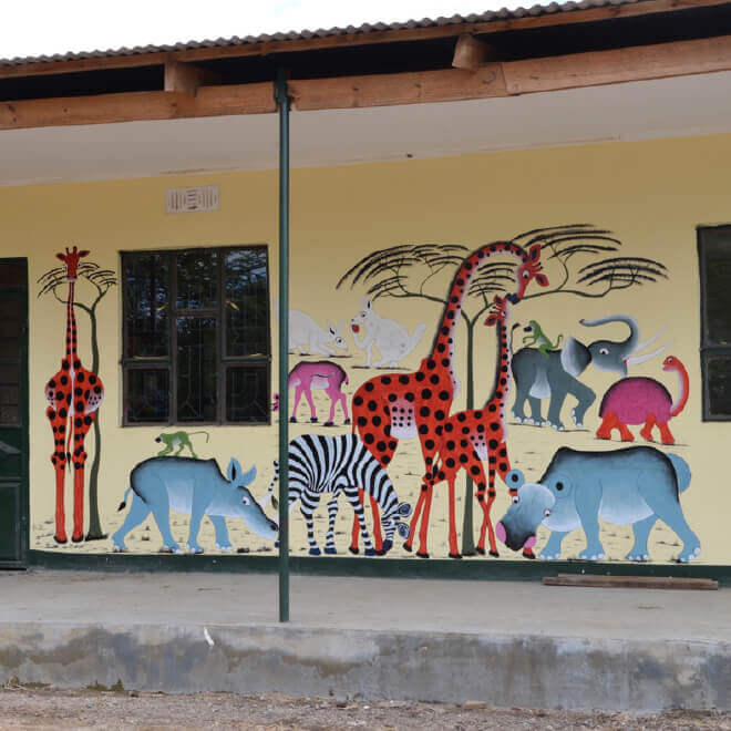 African animals painted mural on school wall