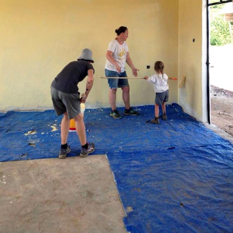 Volunteers painting walls at the Bandari Project
