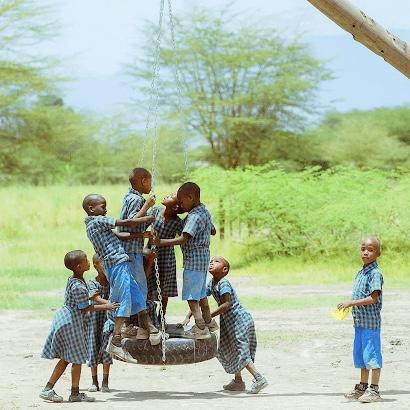 Bandari students playing on tyre swing